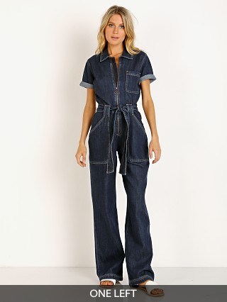 Model in rinse Wrangler Coveralls