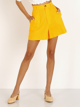Model in canary yellow linen Show Me Your Mumu Stewart Shorts