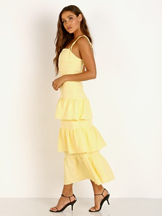 Model in lemon Capulet Quinn Tiered Dress