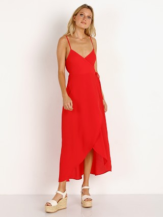 Model in tomato red peddle Show Me Your Mumu Meghan Wrap Dress