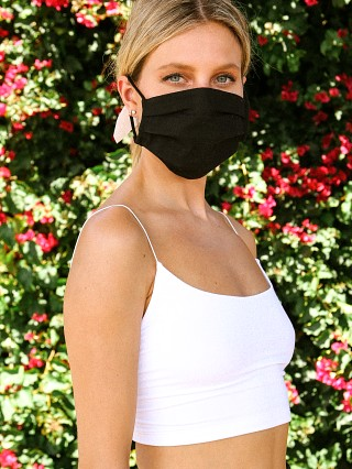 Model in black Largo Drive 100% Cotton Face Mask