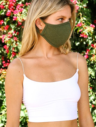 Model in army green Largo Drive Stretch Cotton Face Mask