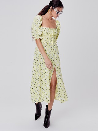 Model in lemonade For Love & Lemons Chrysanthemum Midi Dress