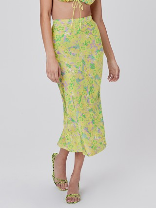 Model in freedom floral For Love & Lemons Dubois Midi Skirt