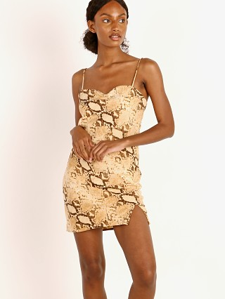 Model in desert python Indah Bea Bias Mini Dress