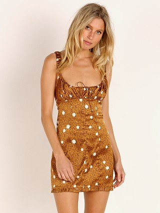 Model in cheetah For Love & Lemons Tawney Mini Dress