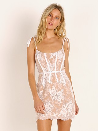 Model in ivory For Love & Lemons Cheyenne Lace Mini Dress