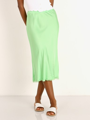 Model in electric lime Nation LTD Mabel Bias Skirt