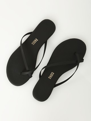 Model in matte black Tkees Riley Vegan Matte Sandal Black