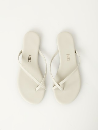 Model in matte grey Tkees Riley Vegan Matte Sandal Grey