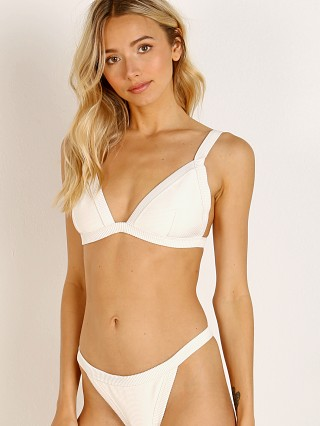 Model in ivory Zulu & Zephyr Harness Bikini Top