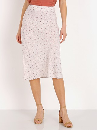 Model in cream Auguste the Label Jasmine Bias Slip Midi Skirt