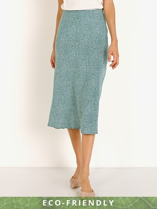 Model in green Auguste the Label Diamond Bias Midi Skirt