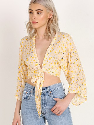 Model in mellow yellow Blue Life Wrapped Top
