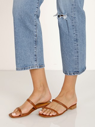Model in rust Jaggar Sprung Sandal