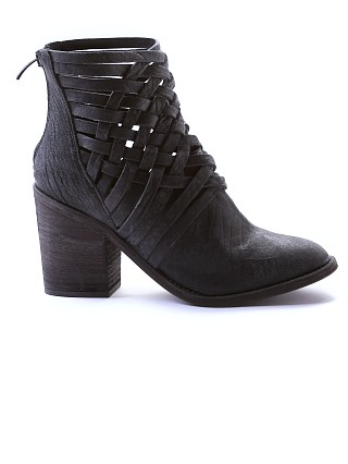 Model in black Free People Carrera Heel Boot