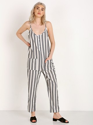 Model in black with cream stripe Knot Sisters Presley Jumpsuit