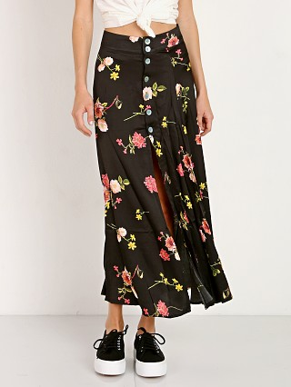 Model in black floral Capulet Madie Midi Skirt