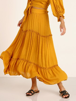 Model in ocher Auguste the Label Farrah Midi Skirt