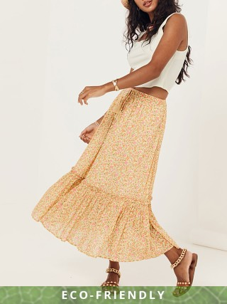 Model in daisy yellow Spell Rae Midi Skirt