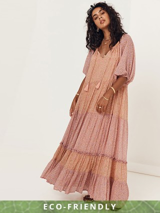 Model in peach Spell Rae Gown