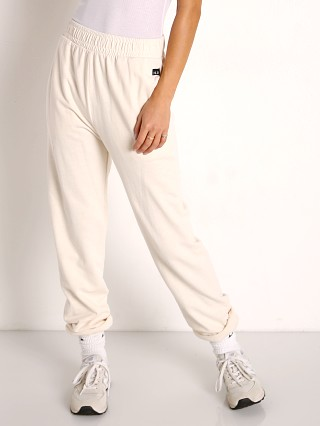 Model in cream NUX Sunday Sweat Pant