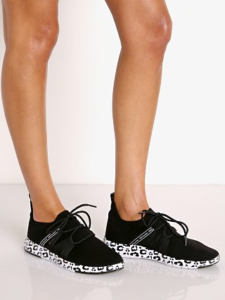 Model in black + leopard Emu Australia Leura Sneaker