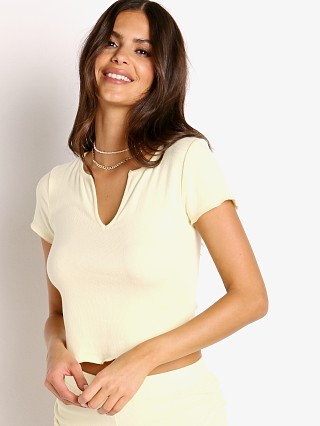 Model in butter NIA The Brand Ribbed Hacci Baby Tee