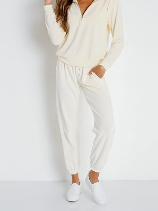 Model in cream DONNI. Terry Henley Sweatpant