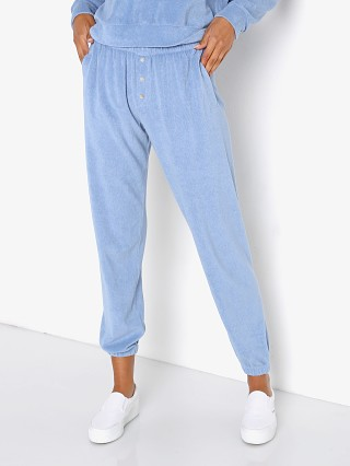 Model in denim DONNI. Terry Henley Sweatpant