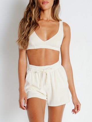 Model in cream DONNI. Terry Henley Short