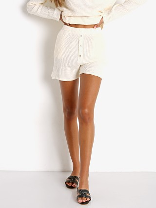 Model in cream + mother of pearl DONNI. Waffle Henley Short