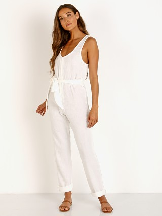 Model in white Stillwater Lost In Love Jumpsuit