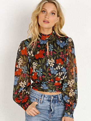 Model in navy floral ASTR the Label Brandi Top