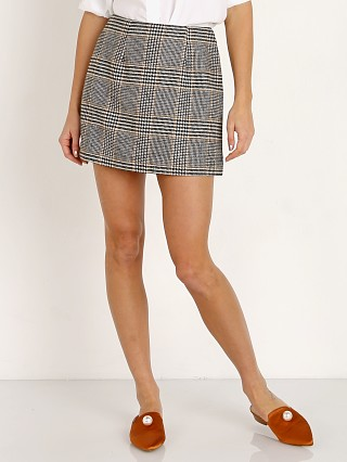 Model in black plaid ASTR the Label Raye Skirt