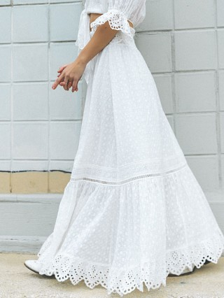 Complete the look: Spell & The Gypsy Daisy Chain Maxi Skirt White