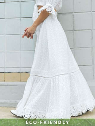 Model in white Spell & The Gypsy Daisy Chain Maxi Skirt