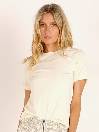 Model in white sage Richer Poorer Fitted Tee