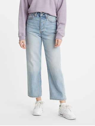 Model in middle road Levi's Ribcage Straight Ankle Jeans