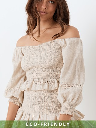 Model in biscuit Spell & The Gypsy Lola Ruched Off Shoulder Top