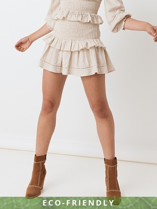 Model in biscuit Spell Lola Ruched Mini Skirt