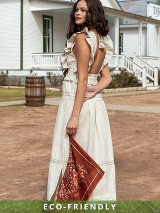 Model in biscuit Spell Lola Frill Maxi Dress