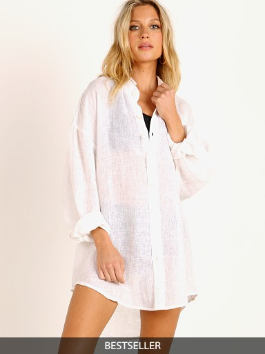 Model in white Vitamin A Eco Linen Playa Shirt Dress