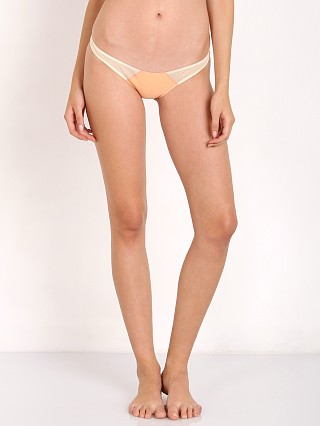 Model in peach House of Au+Ora Hot Stuff Bikini Bottom