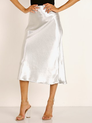 Model in silver LNA Clothing Shine Bias Skirt