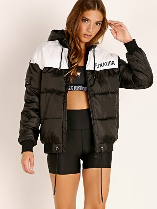 Model in black PE NATION Lead Right Puffer Jacket