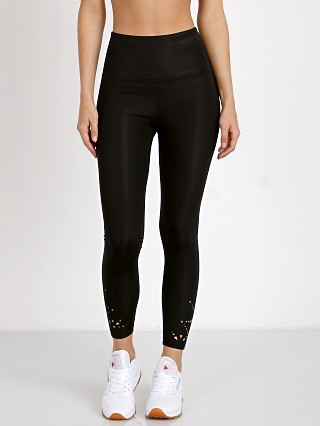 Model in black Beyond Yoga Knit Down High Wasited Midi Legging