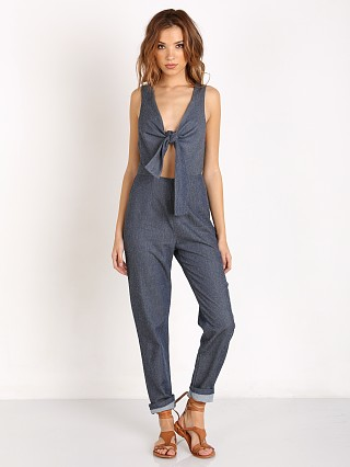 Model in indigo Solid & Striped The Jumpsuit
