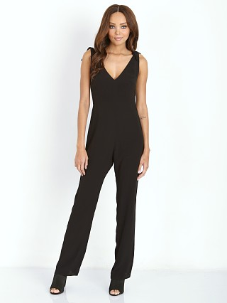 Model in black For Love & Lemons Midnight Tide Jumpsuit