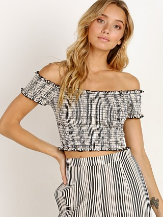 Model in highway stripe flux Show Me Your Mumu Truvy Smocked Top